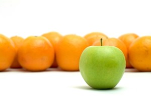 Several Oranges and One Green Apple