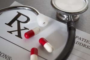 Stethoscope and Pill Capsules on Prescription Pad