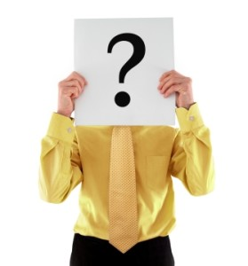 Man Holding Question Mark in Front of Face