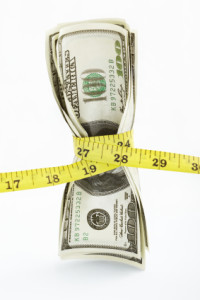 Money Squeezed by Tape Measure