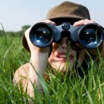Woman in Green Grass with Binoculars