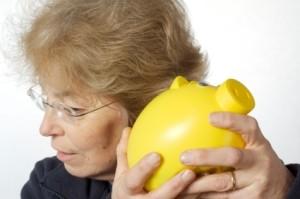 Senior Lady with Piggy Bank