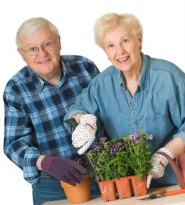 Senior Couple with Flower Pots