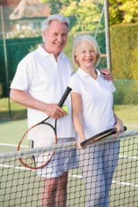 Senior Couple at Tennis Net